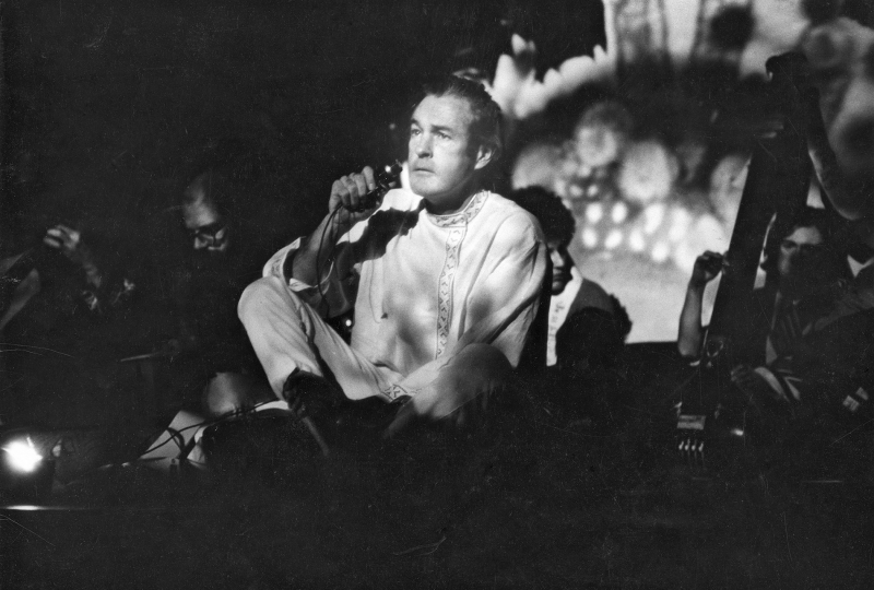 Timothy Leary sits on the stage at the Village Theater, 105 Second Ave., as he hosts his multimedia presentation Illumination of the Buddha, December 6, 1966 Vintage gelatin silver print, printed ca. 1966 -Copyright Fred W. McDarrah, Courtesy Steven Kasher Gallery, New York