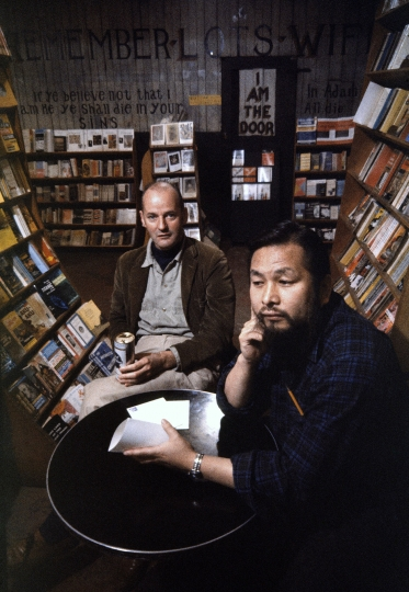 USA. San Francisco. 1960. City Lights bookstore. Lawrence Ferlighetti and manager Shigeyoshi Murao. The City Lights is the mecca for all beat writers and many of them recieve their mail here. The shop use to be a mission house hence the sign on the wall unaltered in the past 50 years, readying,