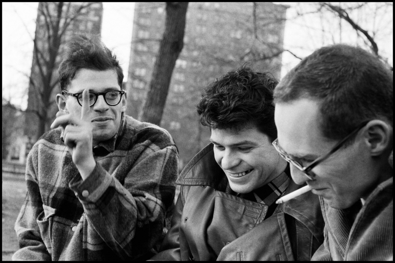 USA. New York City. 1957. Allen GINSBERG, Gregory CORSO, and Barney ROSSET in Washington Square Park. © Burt Glinn / Magnum Photos