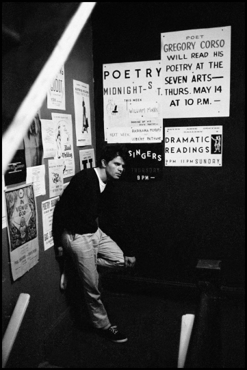 USA. New York City. 1959. Beat writer Gregory CORSO on a stairway at Seven Arts Coffee Gallery. © Burt Glinn / Magnum Photos