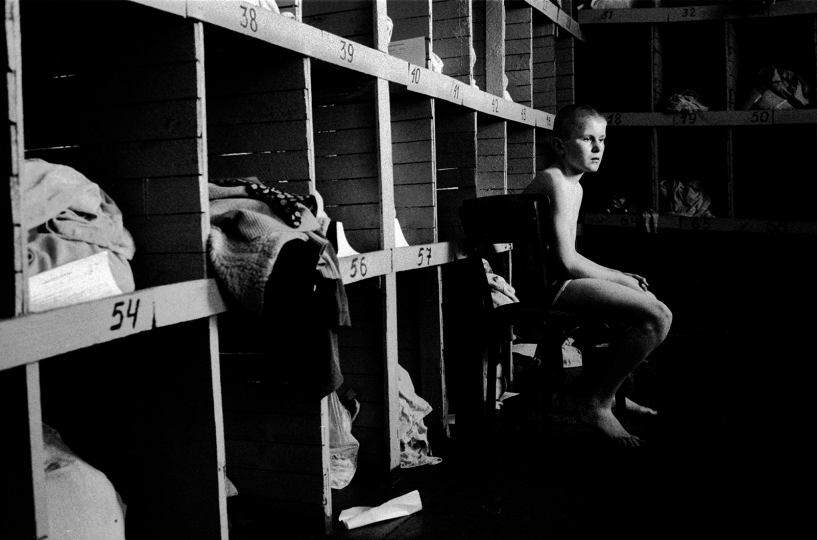 Inmate in the cloakroom of the Kyiv Detention Center for stray children. Ukraine, 1997 © Alexander Glyadyelov