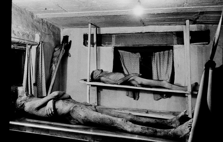 Morgue in the TB colony # 33. In the foreground is the body of prisoner Zakharov. He died from starvation on the way from Moscow to the corrective labor colony #33 in Siberia (January 9 - January 24, 2001). Mariinsk, Russia, 2001 © Alexander Glyadyelov