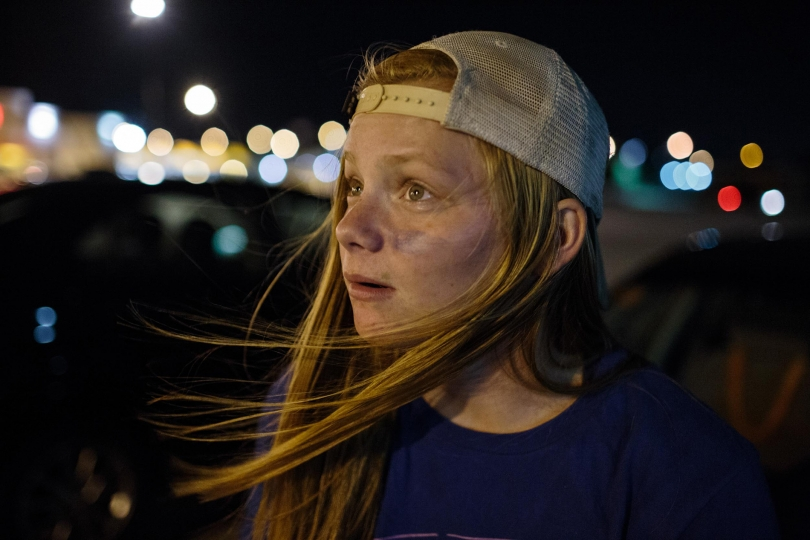Elizabeth Nelson, 17, waits in the parking lot of Home Depot waiting for her friends after watching their team their first football game of the season, 25 August 2017, Omaha, Nebraska. . Nelson enlisted to the army the summer before her senior year of high school, and will ship out to boot camp three days after she graduates.