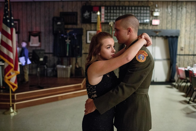 "Garett, a senior member of the Young Marines, dances with his girlfriend at a Young Marines attend a ball at the local VFW, 21 Oct 2017, Hanover, PA. The ball is celebrated once a year, with family and friends celebrating the students success in the program. - ""Beckon Us From Home"" © Sarah Blesener – Courtesy W. Eugene Smith Memorial Fund"