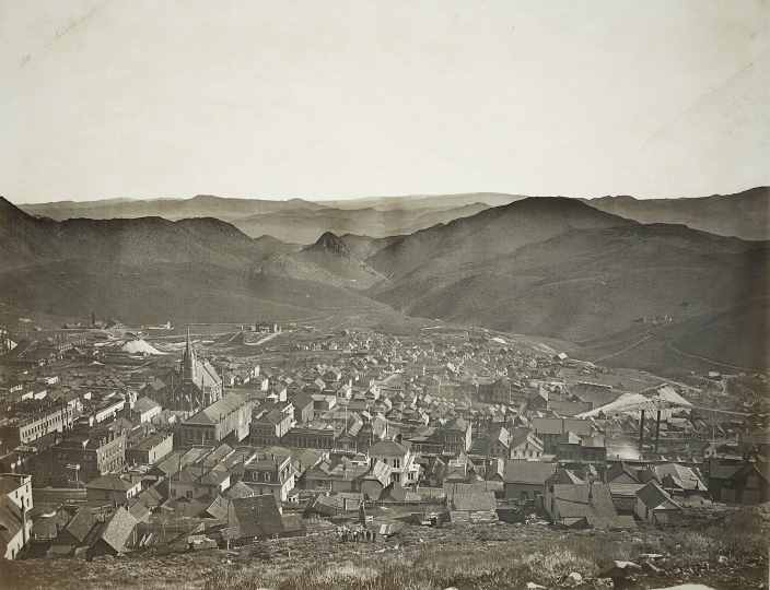 CARLETON WATKINS Virginia City From Water Flume 1878 Glass positive. 13 3/4 x 17 3/4 in. (34.9 x 45.1 cm) Credited, titled and annotated '424' in the glass margin. Image courtesy of Phillips Estimate: $20,000 - 30,000