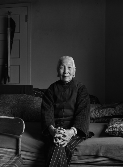 Mrs. Chiu in her apartment, NY, 1981 © Bud Glick Mrs. Chiu had been separated from her husband for most of their marriage because of US immigration laws. Not too long after she immigrated he died. She was living alone in an apartment on Pearl St.