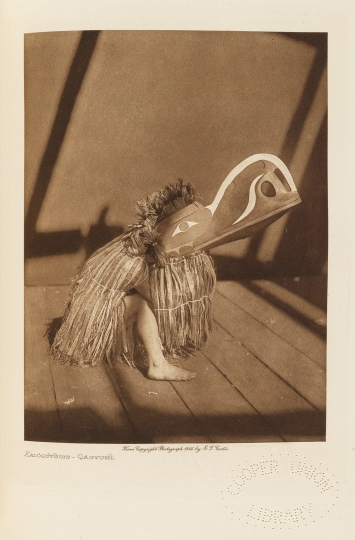 Kalóqŭtsuis – a masked dancer of the Qáĥgyuĥl. - The North American Indian by Edward S Curtis - courtesy of Swann Auction Galleries