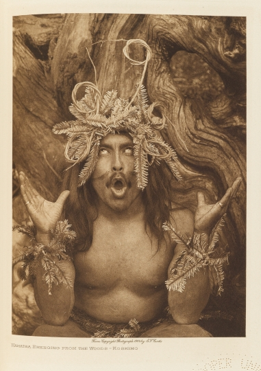 Hamatsa emerging from the woods – Koskimo. British Columbia. - The North American Indian by Edward S Curtis - courtesy of Swann Auction Galleries
