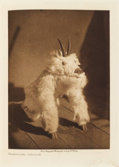Táwihyilahl – a masked dancer of the Qáĥgyuĥl. - The North American Indian by Edward S Curtis - courtesy of Swann Auction Galleries