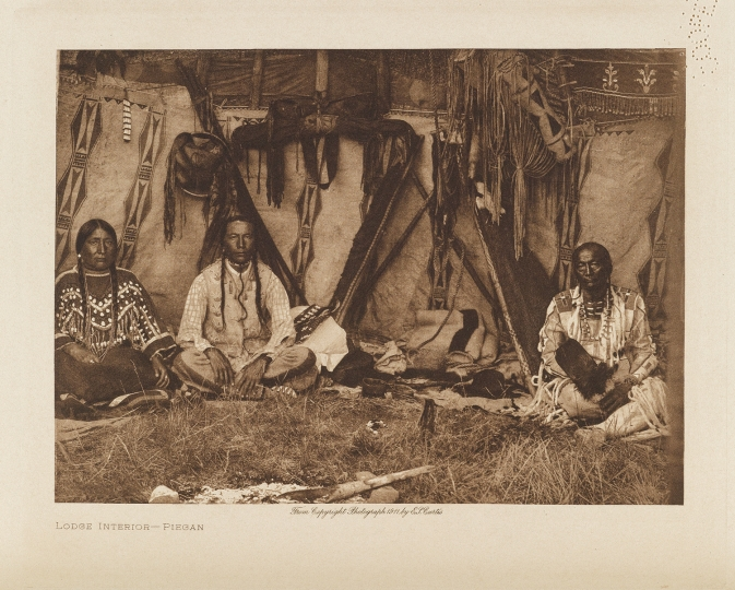 A lodge interior of the Piegan, members of the Blackfoot confederacy. - The North American Indian by Edward S Curtis - courtesy of Swann Auction Galleries