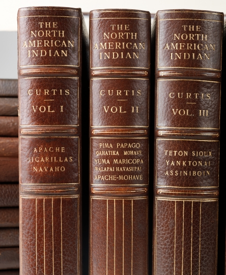 Three of the 20 volumes from The North American Indian. The North American Indian by Edward S Curtis - courtesy of Swann Auction Galleries