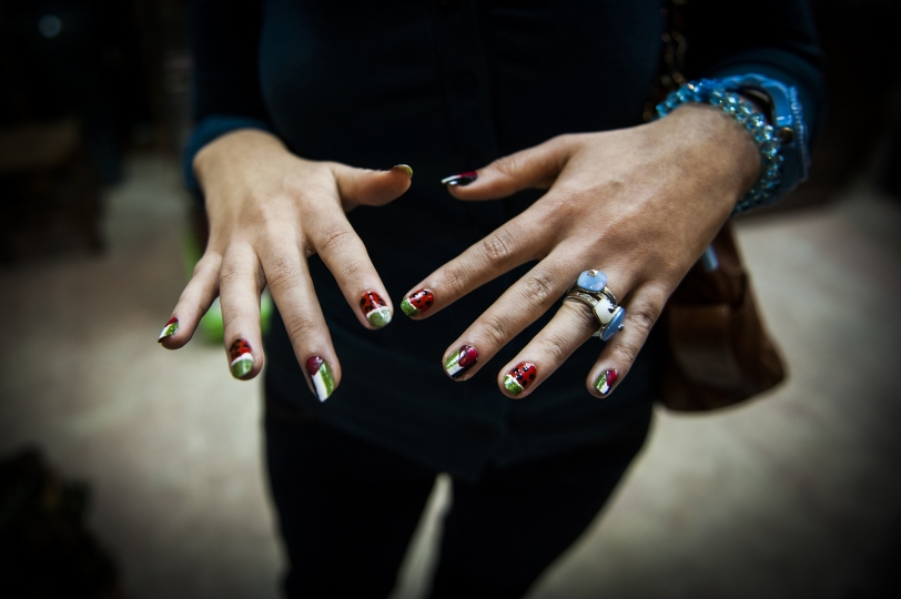 A girl shows off her Palestinian themed nails after a recent bombing campaign. - Gaza Girls: Growing Up in the Gaza Strip © Monique Jaques