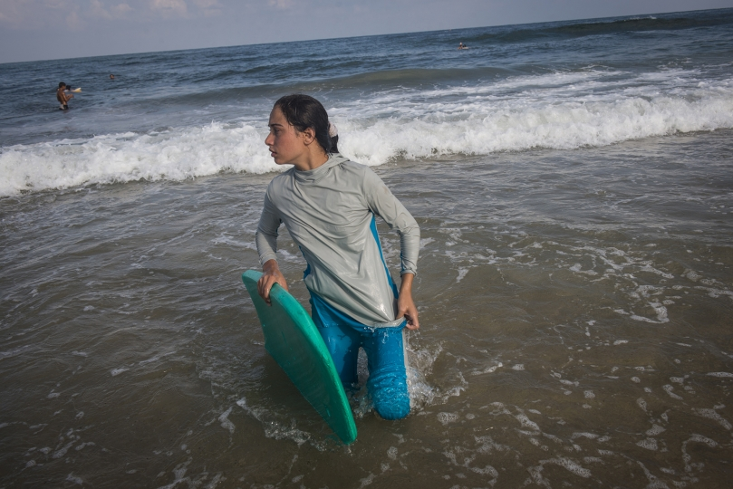 For many Gazans the sea is the only place they can be without being reminded of their isolation. Female Surfer, Sabah Abu Ghanem ,14 and her sister surf early in the morning outside of Gaza city. The sisters place first in many competitions inside the strip, but have never left the Gaza Strip to compete. - Gaza Girls: Growing Up in the Gaza Strip © Monique Jaques