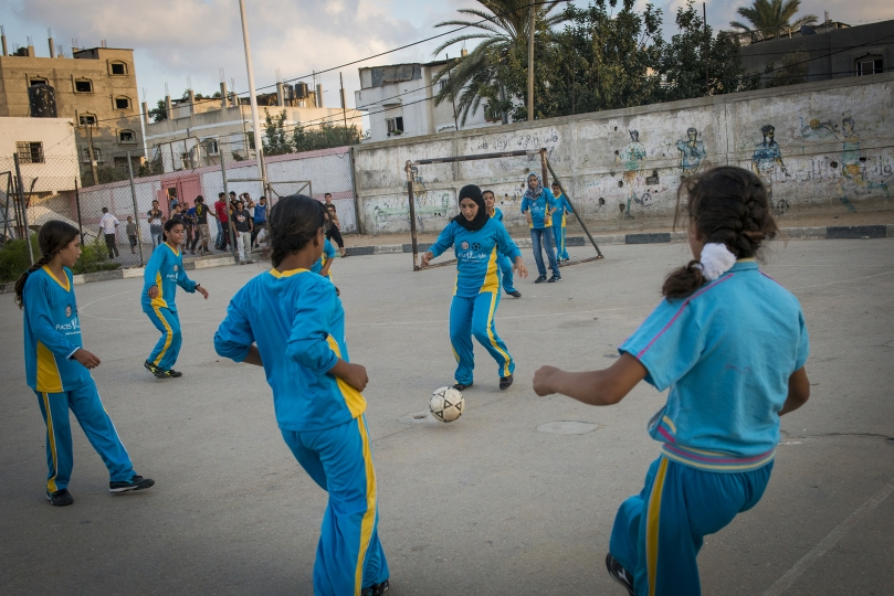 Girls play football in the Northern Gaza town of Beit Lahiyah. Women in Gaza typically do all types of sports till the age of 16, when family pressure forces them to stop as many families seek to find husbands for them. - Gaza Girls: Growing Up in the Gaza Strip © Monique Jaques