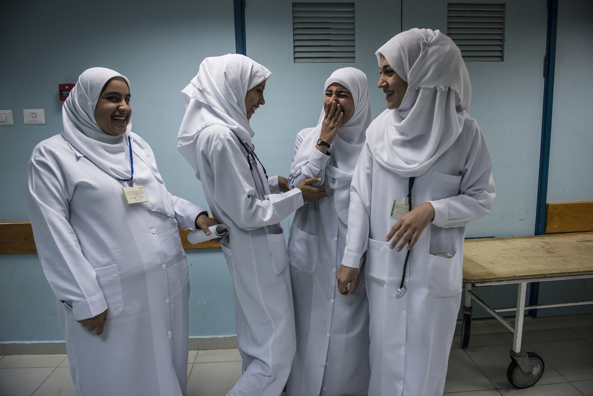 Medical students from Islamic University on break in the Maternity Ward of Al-Shifa Hospital in Gaza.  - Gaza Girls: Growing Up in the Gaza Strip © Monique Jaques