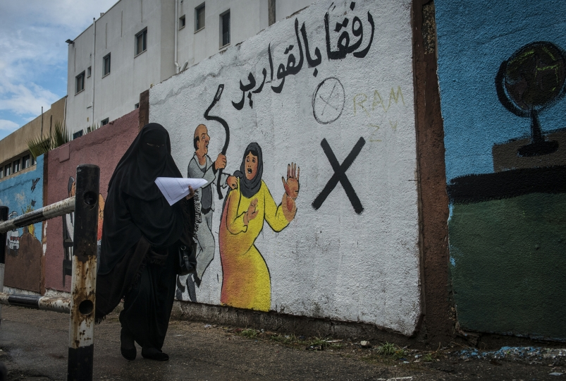 A woman walks by an mural discouraging domestic violence outside if Al-Shifa hospital. According to a 2012 study, some 37% of women are subjected to domestic violence by their husbands. - Gaza Girls: Growing Up in the Gaza Strip © Monique Jaques