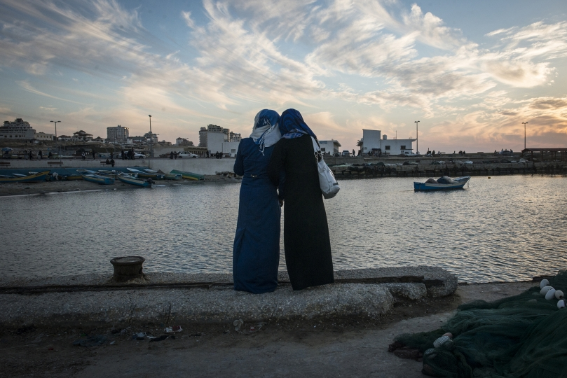 Girls watch the sun set at the harbor in Gaza City. While living in Gaza is undeniably tough, being a woman there is harder. - Gaza Girls: Growing Up in the Gaza Strip © Monique Jaques