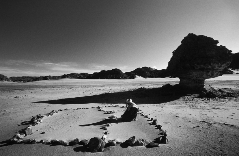 "Sometimes four stones suffic to make a sacred enclosure in the Sahara of the Tuareg, in Libya. "" Broken Songlines / Three Manuscripts"" © Monika Bulaj – Courtesy W. Eugene Smith Memorial Fund"