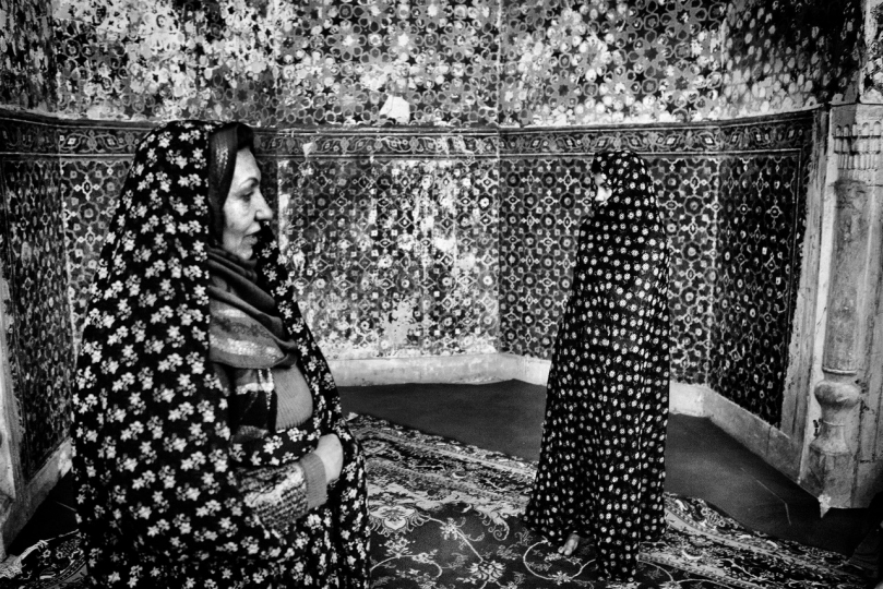 "Mother and daughter, refugees in Iran, have returned to their country, and the first visit they make to a Sufi saint, Afghanistan 2010 "" Broken Songlines / Three Manuscripts"" © Monika Bulaj – Courtesy W. Eugene Smith Memorial Fund"