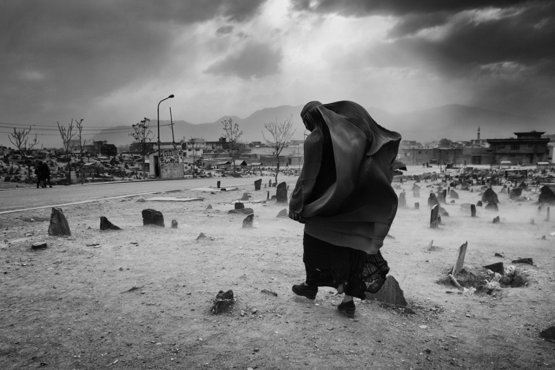 "Kabul, the cemetery close to the shia shrine, the target of the terrorist attacks. "" Broken Songlines / Three Manuscripts"" © Monika Bulaj – Courtesy W. Eugene Smith Memorial Fund"