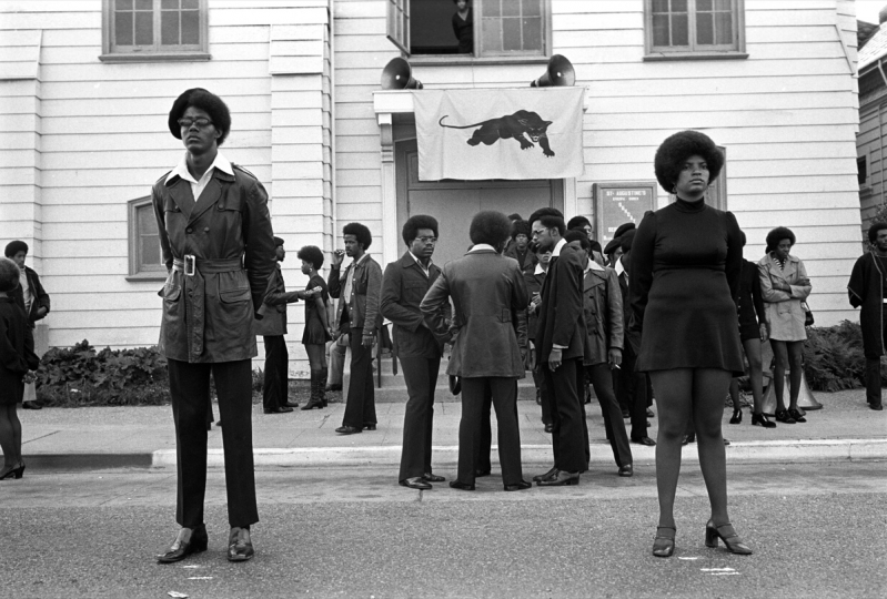 August 28, 1971 - Oakland, California, USA: George Jackson funeral at St. Augustine's Church. Glen Wheeler and Claudia Grayson, known as Sister Sheeba, stand in front. Clark Bailey, known as Santa Rita has cigarette in his mouth. 2nd row: Van Hilliard, known as Van Junior, John Seale (Bobby's brother back to us), Van Taylor. (Stephen Shames/courtesy Stephen Kasher Gallery)