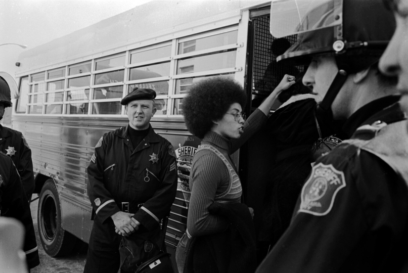Fania Jordan, Angela Davis' sister is arrested at Angela's trial. In August of 1970, Jonathan Jackson, George's younger brother, took weapons to the Marin County Courthouse and took hostages which he intended to trade for his brother. He was killed in the attempt. He used a gun belonging to Angela Davis. 1972