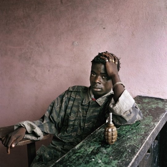 Liberia. Tubmanburg. June 16th, 2003. Young rebel fighter and hand grenade. ©Tim Hetherington / Magnum Photos