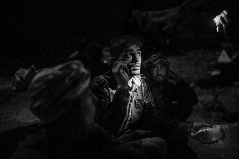 """ Rising From the Ashes of War"" © Enayat Asadi – Courtesy W. Eugene Smith Memorial Fund"
