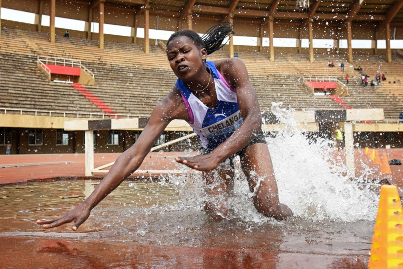 Richard Sanya 1st Place, Sport The Fall Silva Chelangat of Uganda lands in a water hazard during the National Athletics Women's 3000 metre steeplechase trials held at the Mandela National Stadium, Namboole, on Saturday February 24th 2018. Athletes were putting the finishing touches to their training ahead of the XXI Commonwealth games which were held in the Gold Coast, Australia.