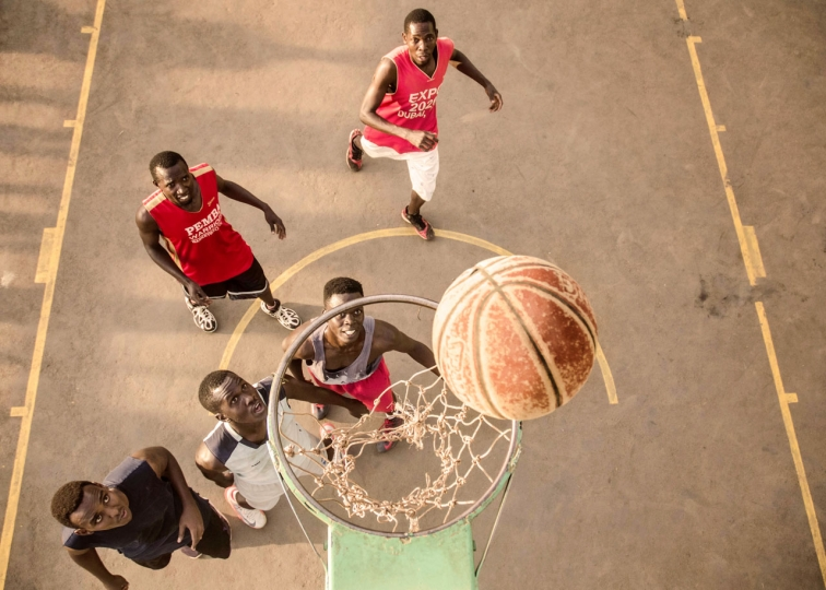 Badru Katumba 2nd Place, Sport Anticipation Young men play basketball at the Makerere University main court on the evening of February 25th 2018
