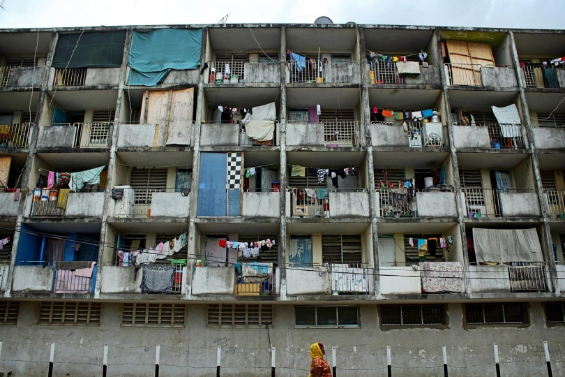 Richard Sanya 2nd Place, Urban City Dwelling A woman walks passed an apartment block on Gerezani Street, Dar es Salaam, Tanzania.