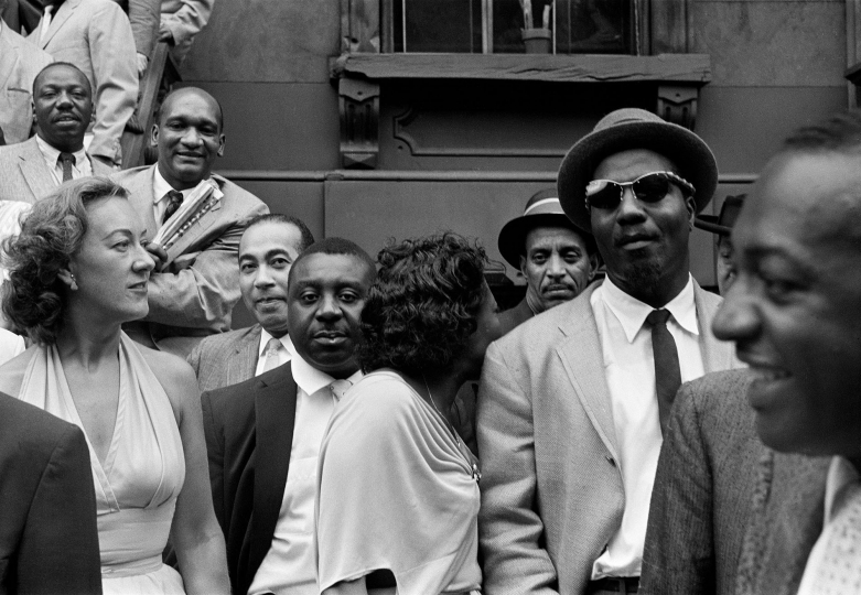 Front row, from left: Marian McPartland, Lawrence Brown, Emmett Berry, Mary Lou Williams (turned back to the camera), Vic Dickenson, Thelonious Monk. Top left, Oscar Pettiford - Art Kane: Harlem 1958: The 60th Anniversary Edition © Art Kane