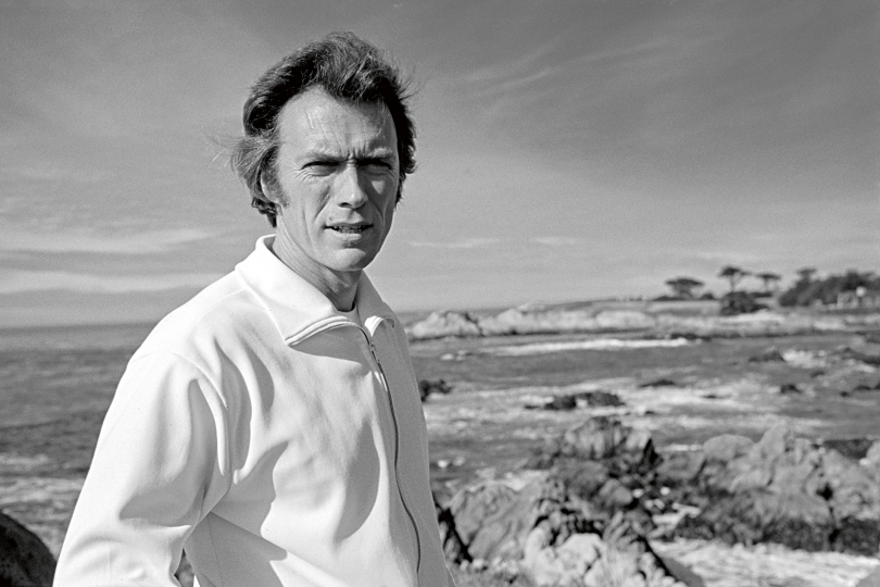 American actor, writer, producer and director, Clint Eastwood standing on the site where he would later build a house and where Eastwood was made mayor from 1986 to 1988, Carmel, California, US, early 1970s. © Eva Sereny