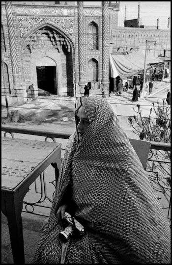 IRAN. Qom. 1956. Inge Morath with the entrance to the Shrine of Fatema in the background. © Inge Morath / Magnum Photos