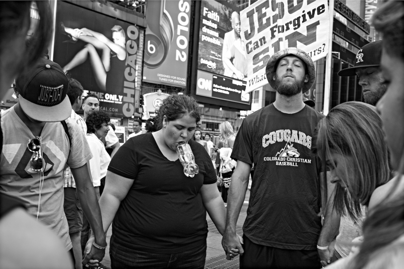 There are always religious tourists there as well as others who evangelize with posters and brochures © Betsy Karel - America's Stage: Times Square