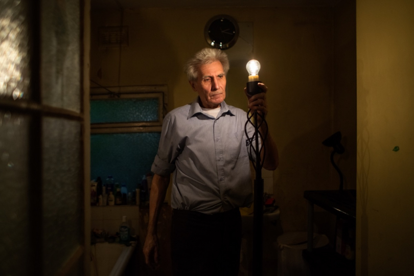 LONDON, UNITED KINGDOM - MAY 08, 2014: Standing in his bathroom, George tests out a floor lamp that he found in the process of decluttering his house May 08, 2014 in London, United Kingdom. © Corinna Kern