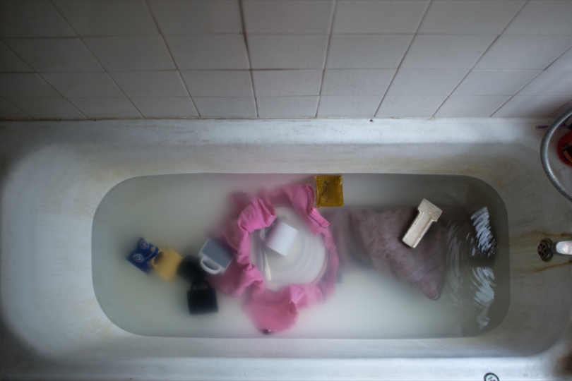 LONDON, UNITED KINGDOM - APRIL 02, 2014: As one of the only accessible spaces, George's bathtub has become the place where he washes the dishes, does his laundry, stores items or repairs bikes, where he has his coffee, reads books or, last but not least, takes a bath April 02, 2014 in London, United Kingdom. © Corinna Kern