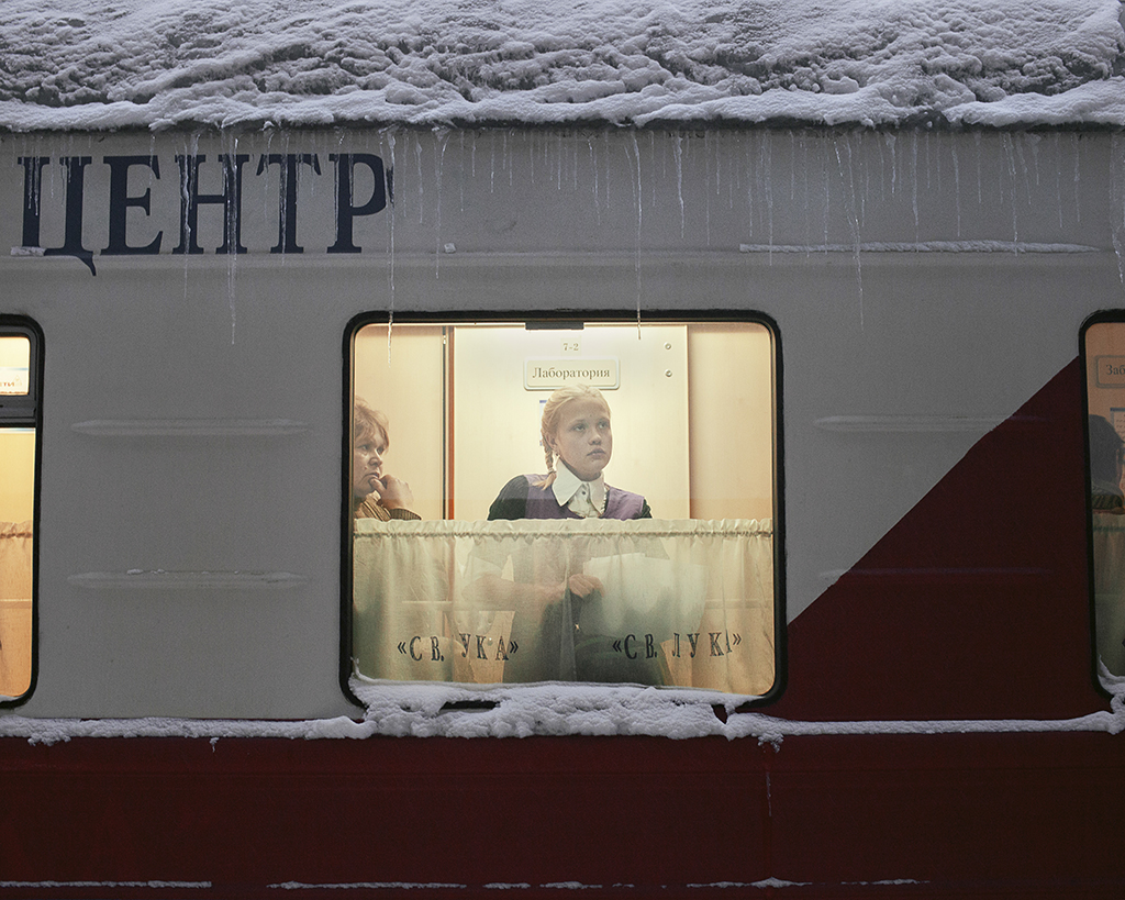On board the medical train 'Saint Lukas' that travels to remote and underserved towns in Siberia. Patients wait for their medical treatment and laboratory results in the narrow gangways of the train. Kuragino, Krasnoyarsk Krai, Russia, 13.11.2016. © Emile Ducke