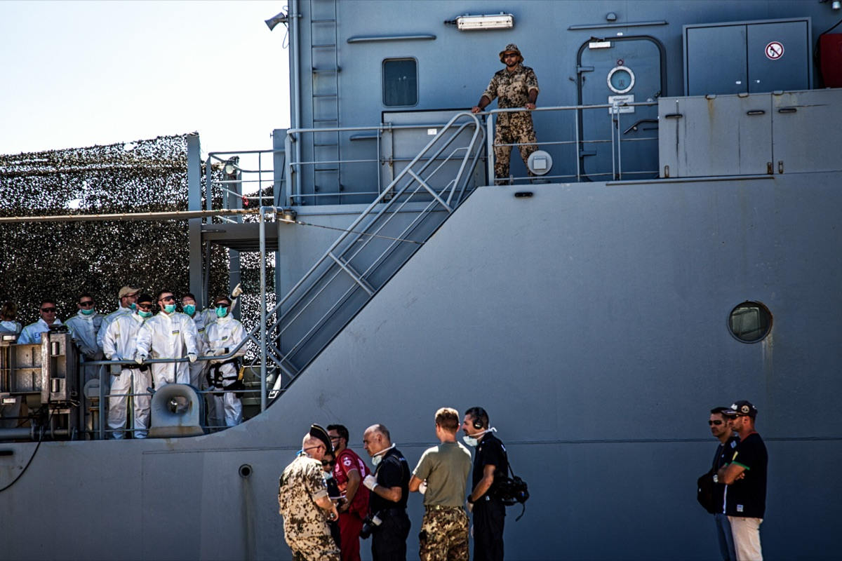 Staff of the Ministry of Health on Werra ship and some land based personal, waiting for the landing of 105 migrants, rescued off the Libyan coast © Max Hirzel
