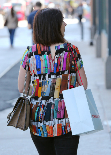 Reading Series--Woman with blouse in book design on Lafayette Street, NYC October 7, 2016. © Lawrence Schwartzwald
