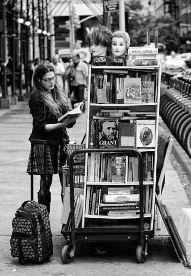 Reading Series--17th st. Union Square, book vendor stand. © Lawrence Schwartzwald