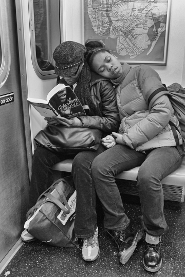 READING-Mother and daughter reading on #2 subway. © Lawrence Schwartzwald
