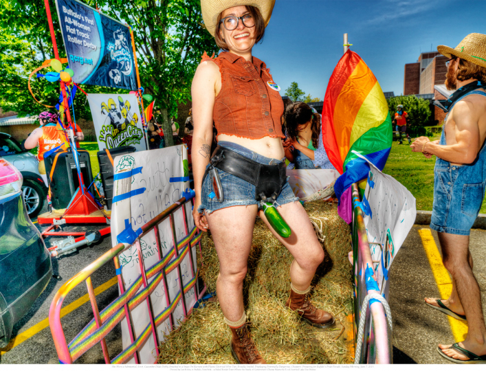 3. She Wore a Substantial, Erect, Cucumber Dildo Deftly Attached to a Snap-On Harness with Plastic Electrical Wire-Ties, and Broadly Smiled, Displaying Potentially Dangerous Choppers. Preparing for Buffalo's Pride Parade, Sunday Morning, June 7, 2015. © Les Krims