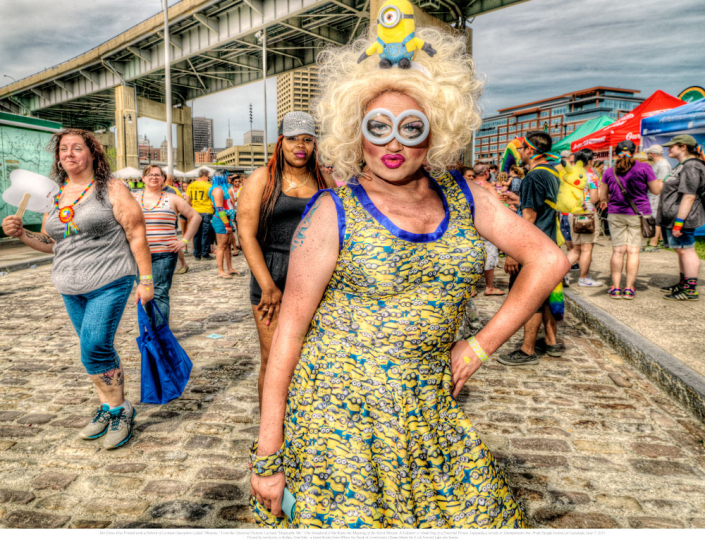 "4. Her Dress Was Printed with a Pattern of Cartoon Characters Called ""Minions,"" From the Universal Pictures' Cartoon ""Despicable Me."" One Wondered if She Knew the Meaning of the Word Minion: A Follower or Underling of a Powerful Person, Especially a Servile or Unimportant One. Pride Parade Festival at Canalside, June 7, 2015. © Les Krims"