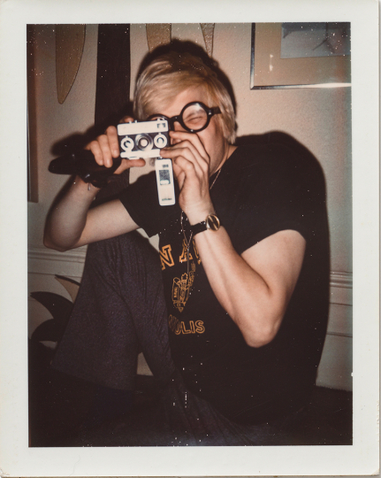 Andy Warhol, David Hockney, ca. 1972, Polaroid, 10.7 x 8.5 cm. © 2018 The Andy Warhol Foundation for the Visual Arts, Inc. Licensed by DACS, London. Courtesy BASTIAN, London