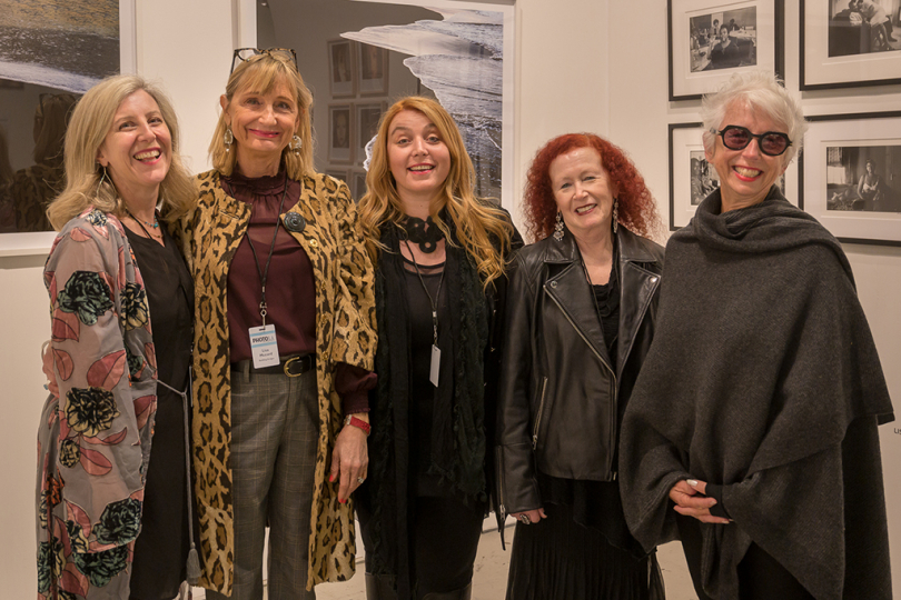 Photographers Sarah Hadley, Lisa McCord, Marisa Caicholo, J.K. Lavin and Marian Crostic in the Building Bridges booth © Andy Romanoff