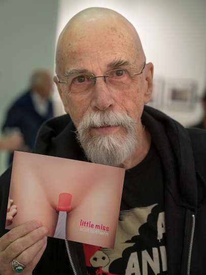Scot Sothern shows off a card announcing a pop-up for his new book. It's happening Saturday night at GNF/Drkrm © Andy Romanoff