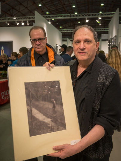 David Martin, curator of the Cascadia Art Museum shows off a vintage print he bought on the floor. © Andy Romanoff