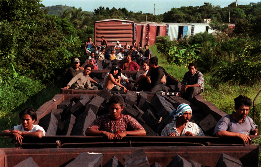 SEPTEMBER 6, 2000. CHIVELA, OAXACA, MEXICO. Dozens of Central American stowaways ride north through the Mexican countryside. Weeks before this, a Grupo Beta migrant protection officer shared his name for the railway: