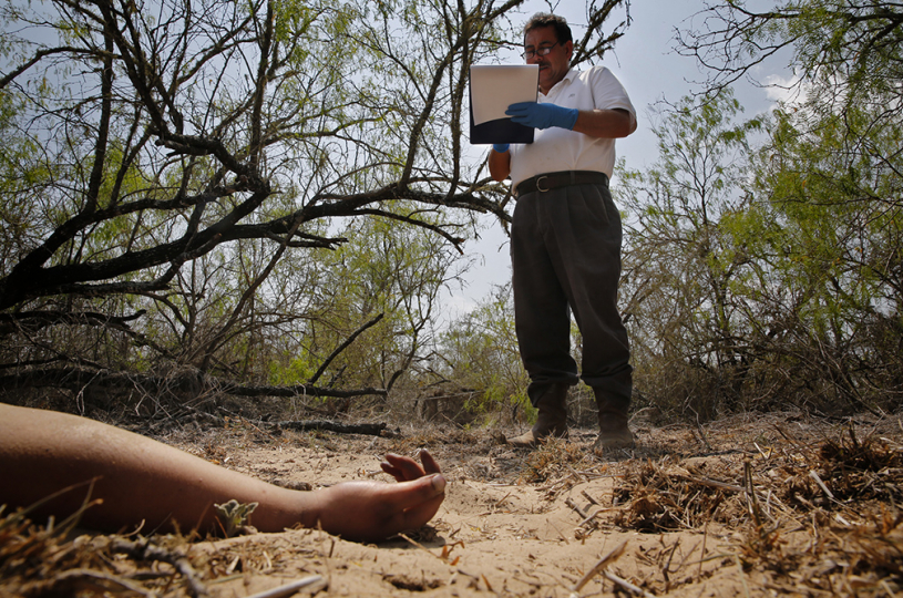"APRIL 8, 2013. FALFURRIAS, TEXAS. ""Corridor of Death"" Forensic investigator Alonzo Rangel notes the corpse of a female found 150 miles north of the Mexican border. She is the 19th illegal immigrant victim recovered this year on what the Brooks County Sheriff calls"